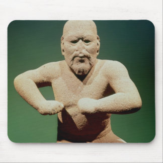 Figurine of a wrestler mouse pad