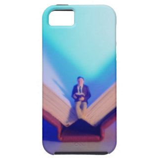 Figurine sitting on open book iPhone 5 case