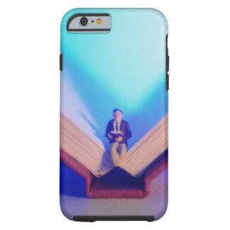Figurine sitting on open book tough iPhone 6 case