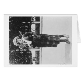 Fijación de la mujer en fotografía del equipo del  tarjeta de felicitación