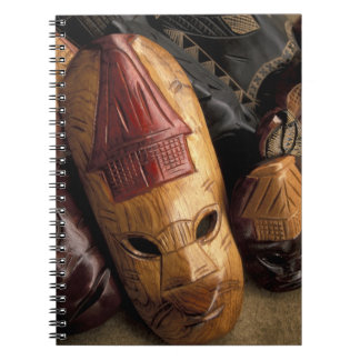 Fiji, Viti Levu Masks at a town market. Note Books