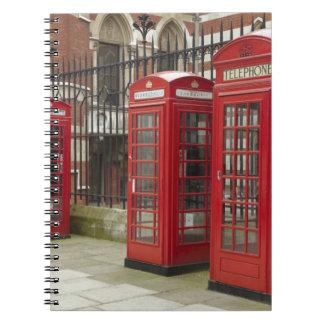 Fila de las cajas del teléfono en la parte posteri spiral notebooks