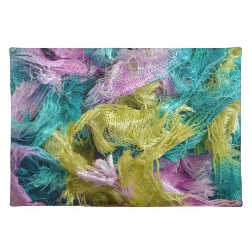 Filamentos coloridos borrosos del fondo del hilado manteles