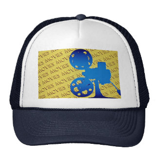 Film projector over yellow movies background mesh hat