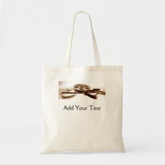 Film Reel in Sepia Tones Background Bags