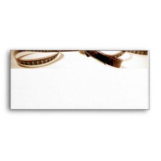 Film Reel in Sepia Tones Background Envelope