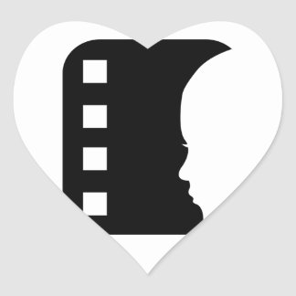 Filmstrip with side view of a woman heart stickers
