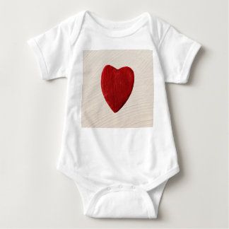 Finery background with heart baby bodysuit