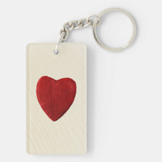 Finery background with heart keychain