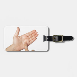 Finger tapping on imaginary smartphone luggage tag