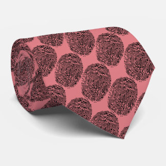 fingerprints with light salmon background tie