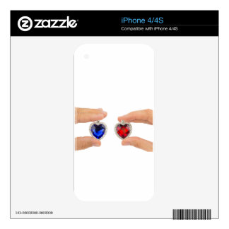 Fingers holding blue and red jewelry hearts iPhone 4S decals