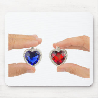 Fingers holding blue and red jewelry hearts mouse pad
