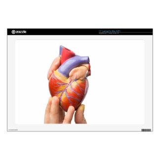 """Fingers showing model human heart on white.jpg skin for 17"""" laptop"""