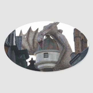 Fire breathing Dragon protecting wizard's bank Oval Sticker