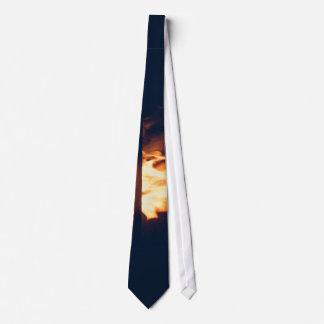 Fire burns in the dark tie