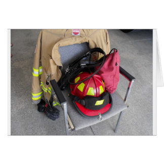 fire fighter helmit on chair greeting card
