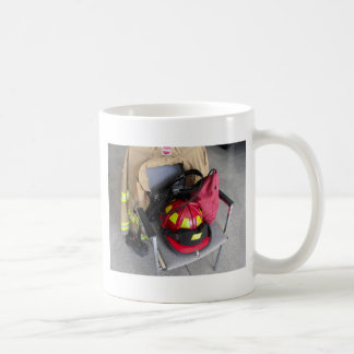 fire fighter helmit on chair coffee mugs