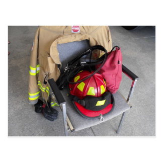 fire fighter helmit on chair post cards