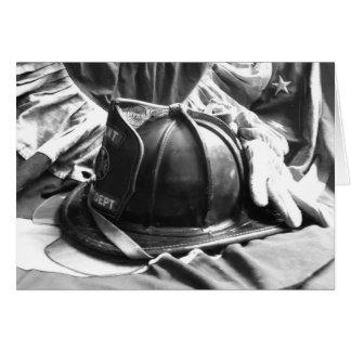 Fire helmet, gloves, flag card