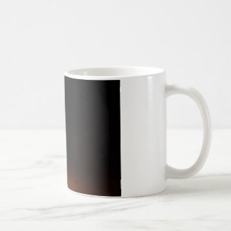 Fire in a bowl isolated in black. coffee mug