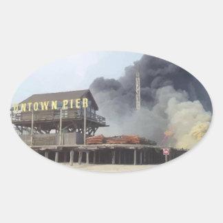 Fire rages along NJ boardwalk damaged by Sandy Oval Sticker