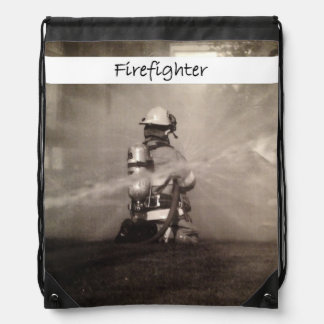 Firefighter At Work Drawstring Bags