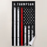 "Firefighter Styled American Flag Custom Beach Towel<br><div class=""desc"">A custom name distressed style Firefighter flag beach towel.  The thin red line running across the entire towel is representative of American Firefighters and fire rescue.  Follow the directions in the sidebar to add a name and to have it look perfect over the flag.</div>"