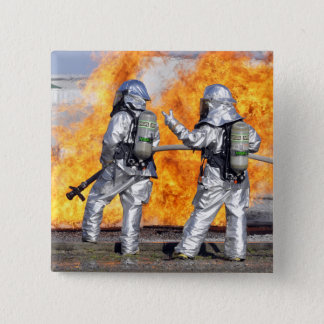 Firefighters battle a simulated fire pinback button