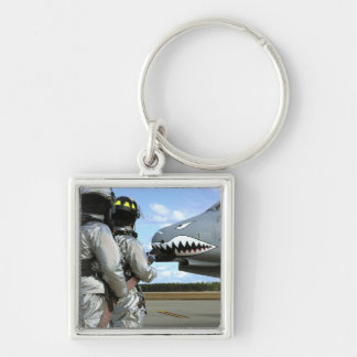 Firefighters deploy a fire hose during a drill keychain