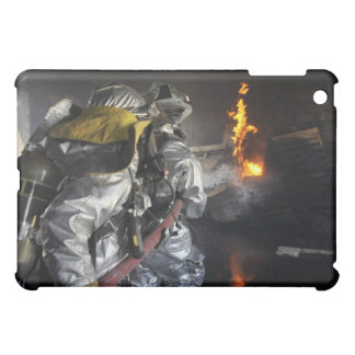 Firefighters extinguish a fire in a training ro cover for the iPad mini
