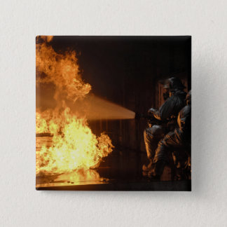 Firefighters extinguish a simulated battery fir button