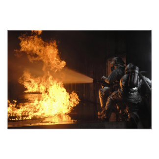 Firefighters extinguish a simulated battery fir photo