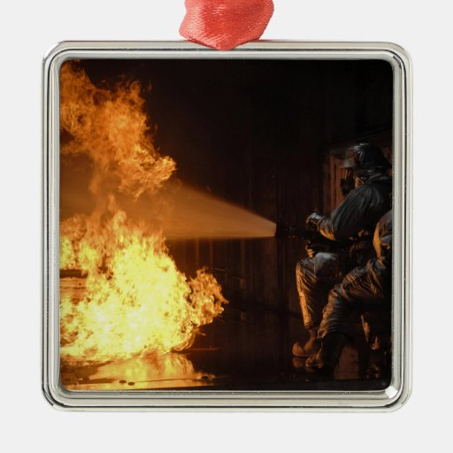 Firefighters extinguish a simulated battery fir square metal christmas ornament