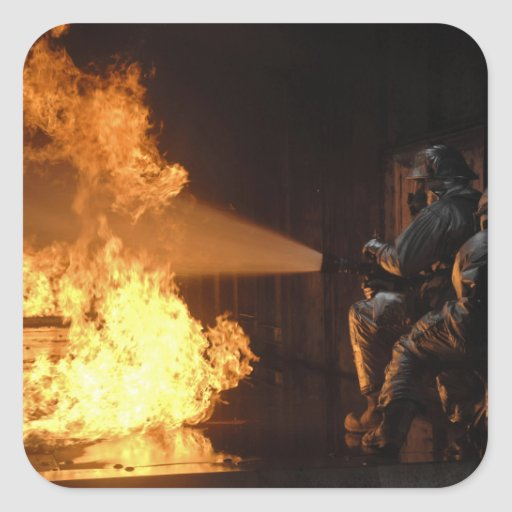 Firefighters extinguish a simulated battery fir square sticker
