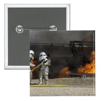 Firefighters neutralize a live fire button