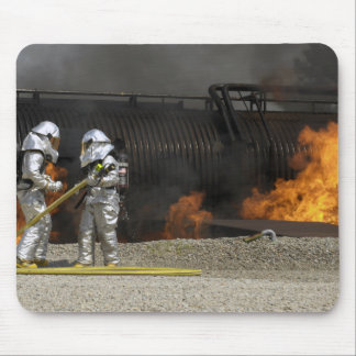 Firefighters neutralize a live fire mouse pad