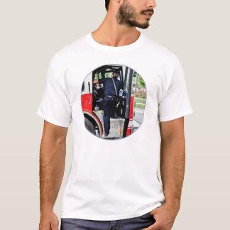 Fireman Climbing into Fire Truck T-Shirt