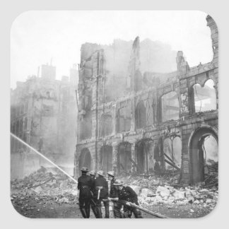 Firemen at work in bomb-damaged street_War image Square Sticker