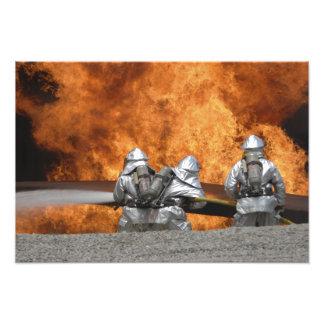 Firemen neutralize a fire photographic print