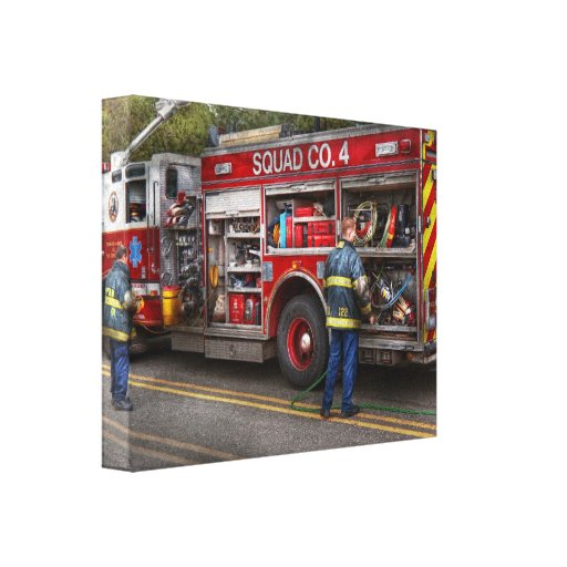 Firemen - The modern fire truck Canvas Print