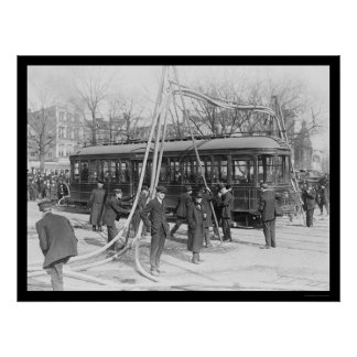 Firemen With Their Hoses Over a Streetcar 1912 Posters