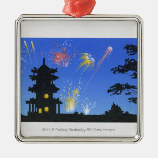 Firework display and silhouette of pagoda metal ornament