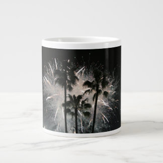 Fireworks behind palm  trees giant coffee mug