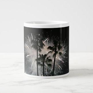 Fireworks behind palm  trees giant coffee mug