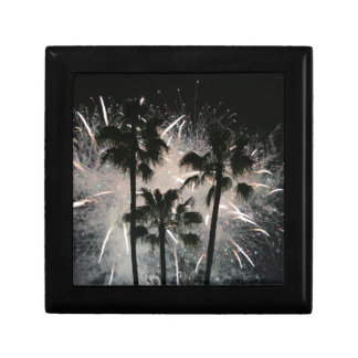Fireworks behind palm  trees gift box