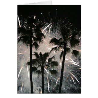 Fireworks behind palm  trees greeting card