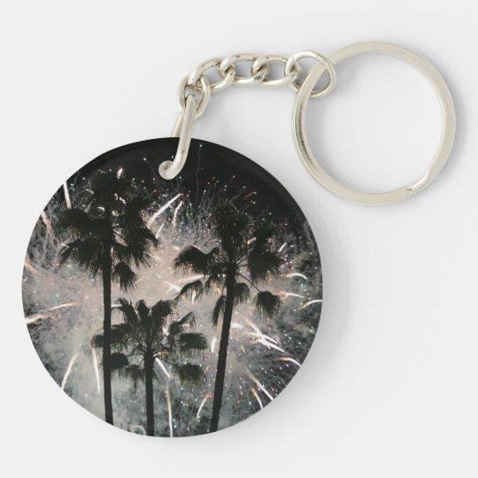 Fireworks behind palm  trees keychain