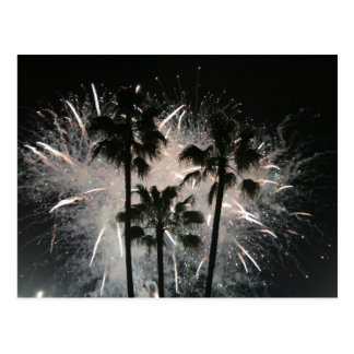 Fireworks behind palm  trees post cards