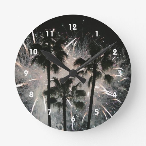 Fireworks behind palm  trees round clock